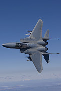 Fighter Plane Photos - An F-15 Eagle Conducts Air-to-air by HIGH-G Productions