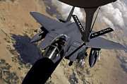 Tanker Framed Prints - An F-15 Strike Eagle Prepares Framed Print by Stocktrek Images