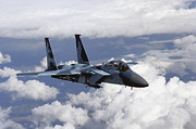Red Eagle Posters - An F-15c Aggressor Flies Poster by Stocktrek Images