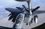 Iraq Prints - An F-15e Strike Eagle Refuels Over Iraq Print by Stocktrek Images