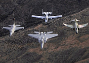 Jets Photos - An F-16 Fighting Falcon, F-15 Eagle by Stocktrek Images