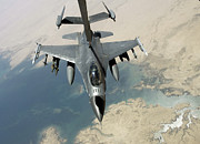 Mechanism Prints - An F-16 Fighting Falcon Refuels Print by Stocktrek Images