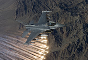 Releasing Framed Prints - An F-16 Fighting Falcon Releases Flares Framed Print by HIGH-G Productions