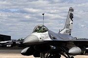 Aviator Posters - An F-16 Fighting Falcon Taxis Poster by Stocktrek Images
