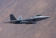 Jetfighter Posters - An F-22 Raptor On A Training Mission Poster by HIGH-G Productions