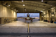 Hangar Framed Prints - An F-22 Raptor Parked In The Hangar Framed Print by HIGH-G Productions