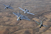 In A Row Art - An F-22a Raptor, An F-4 Phantom, An by Stocktrek Images