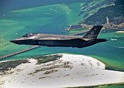 Aerial View Posters - An F-35 Lightning Ii Flies Over Destin Poster by Stocktrek Images