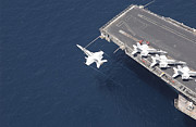 Supercarrier Prints - An Fa-18 Hornet Flys Over Aircraft Print by Stocktrek Images