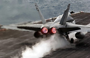 Carrier Posters - An Fa-18 Hornet Launches Poster by Stocktrek Images