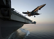 Carrier Prints - An Fa-18a Hornet Clears The Flight Deck Print by Stocktrek Images