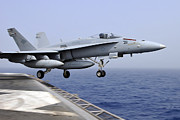 On The Runway Photos - An Fa-18c Hornet Catapults by Stocktrek Images
