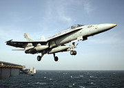 Carrier Prints - An Fa-18c Hornet Clears The Flight Deck Print by Stocktrek Images