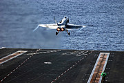 Carrier Framed Prints - An Fa-18c Hornet Launches From Aircraft Framed Print by Stocktrek Images