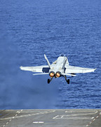 Carrier Prints - An Fa-18c Hornet Launches From The Uss Print by Stocktrek Images