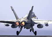 F-18 Prints - An Fa-18c Hornet Launches In Full Print by Stocktrek Images