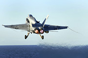 Supercarrier Prints - An Fa-18c Hornet Launches Print by Stocktrek Images