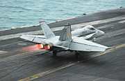 Carrier Prints - An Fa-18c Hornet Makes An Arrested Print by Stocktrek Images