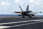 Carrier Prints - An Fa-18c Hornet Successfully Lands Print by Stocktrek Images