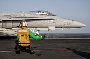 Kneeling Prints - An Fa-18c Is Ready To Launch Print by Giovanni Colla