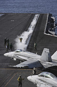 F-18 Prints - An Fa-18d Hornet Taxis To The Catapult Print by Stocktrek Images
