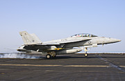Braking Posters - An Fa-18e Super Hornet Lands Aboard Uss Poster by Giovanni Colla