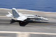 Flight Deck Posters - An Fa-18e Super Hornet Lands Aboard Uss Poster by Stocktrek Images