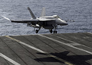 Aircraft Carrier Prints - An Fa-18e Super Hornet Prepares To Land Print by Stocktrek Images