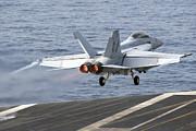 Uss Ronald Reagan Prints - An Fa-18f Super Hornet Launches Print by Stocktrek Images