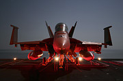 Aircraft Carrier Prints - An Fa-18f Super Hornet Parked Print by Stocktrek Images