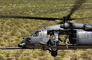 Flying Angel Photos - An Hh-60 Pave Hawk Flies by Stocktrek Images