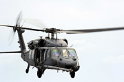 Helicopter Art - An Hh-60 Pave Hawk Helicopter Conducts by Stocktrek Images
