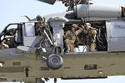 Helicopter Art - An Hh-60 Pave Hawk Helicopter Crew by Stocktrek Images