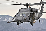 Helicopters Posters - An Hh-60 Pave Hawk Helicopter In Flight Poster by Stocktrek Images