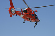 Search And Rescue Photos - An Hh-65c Dolphin Demonstrates by Stocktrek Images