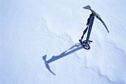 An Ice Axe In The Snow Print by Kenneth Garrett