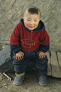 An Informal Portrait Of A  Kazakh Child Print by David Edwards