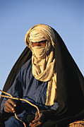 Ethnic And Tribal Peoples Framed Prints - An Informal Portrait Of A Tuareg Man Framed Print by Michael S. Lewis