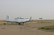 Taxiway Posters - An Iraqi Air Force T-6 Texan Trainer Poster by Terry Moore