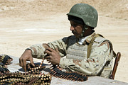 7.62mm Framed Prints - An Iraqi Army Soldier Prepares Belts Framed Print by Stocktrek Images