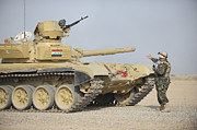 Iraqi Framed Prints - An Iraqi Officer Directs A T-72 Tank Framed Print by Stocktrek Images