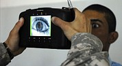 Iraq Prints - An Iraqi Police Recruit Holds His Eye Print by Everett