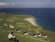 Scenic Overlooks Prints - An Irishman Overlooks Cottages That Print by Howell Walker