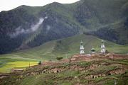 Peoples Republic Of China Photos - An Islamic Village And Mosque by David Evans