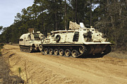 Artillery Photo Metal Prints - An M-88 Recovery Vehicle Begins To Tow Metal Print by Stocktrek Images