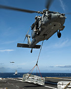 Flight Deck Posters - An Mh-60s Sea Hawk Helicopter Lowers Poster by Stocktrek Images