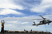 Pallet Prints - An Mh-60s Sea Hawk Lifts A Pallet Print by Stocktrek Images