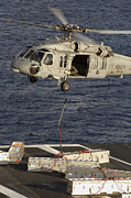 Pallet Framed Prints - An Mh-60s Seahawk Delivers Ammunition Framed Print by Stocktrek Images