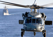 Uss Leyte Gulf Posters - An Mh-60s Seahawk Helps Conduct Poster by Stocktrek Images