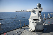 Gun Barrel Framed Prints - An Mk-38 Machine Gun System Aboard Uss Framed Print by Stocktrek Images